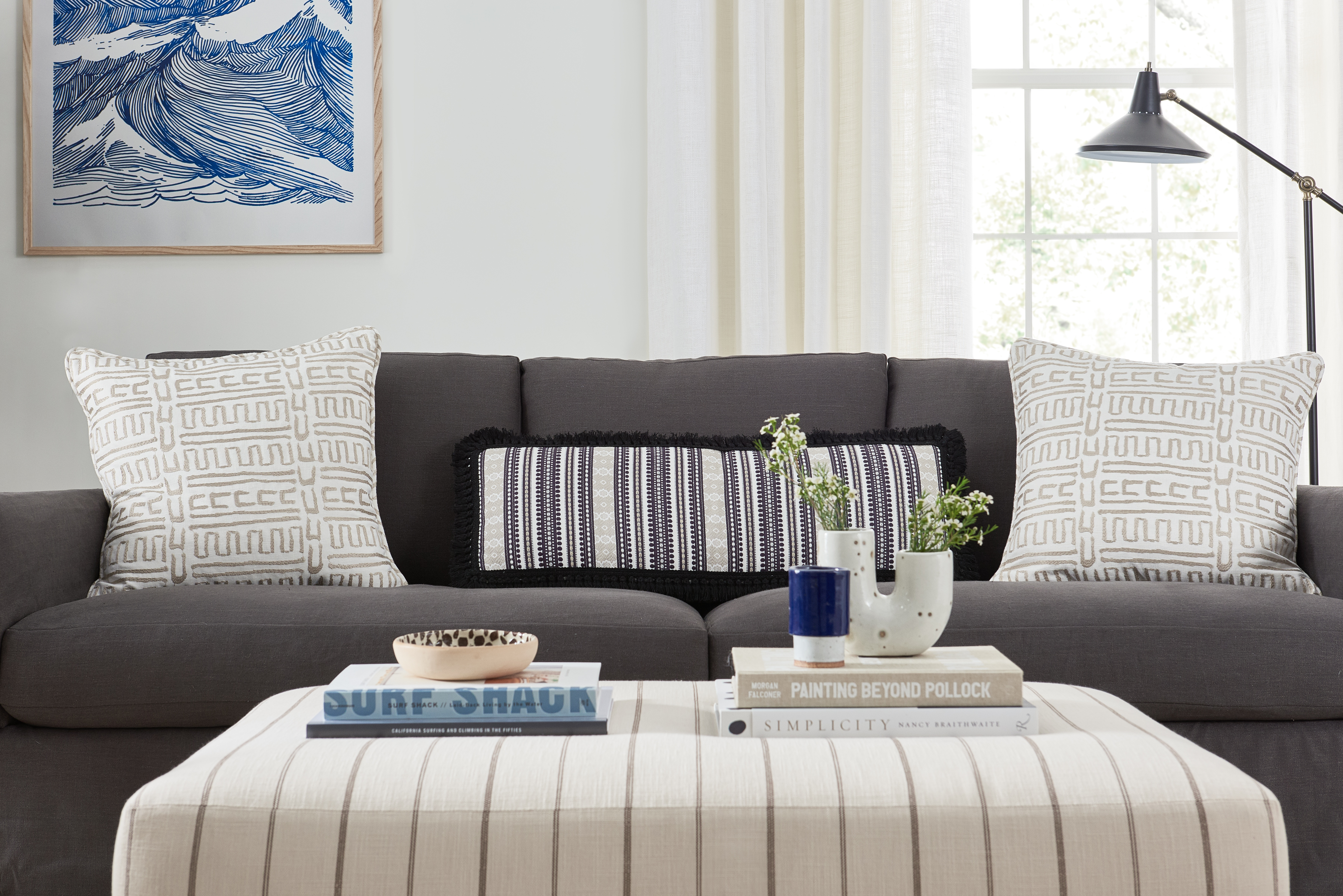 Modern bohemian living room, coastal chic interior design, black and white bohemian