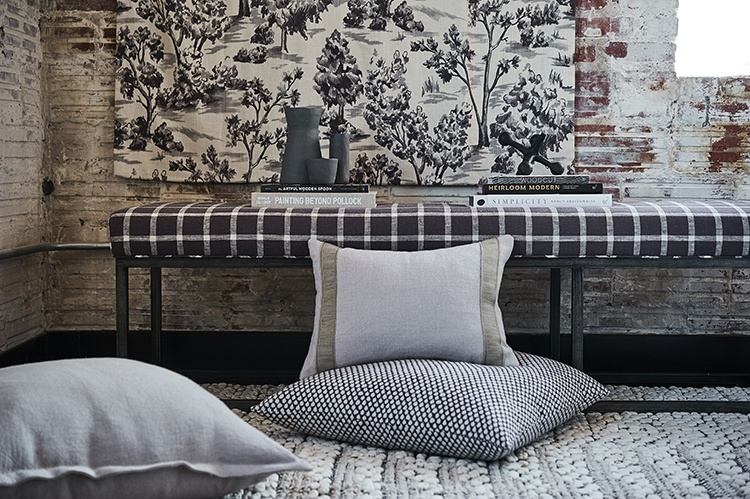 French General grey fabrics and trimmings in a brick industrial modern loft
